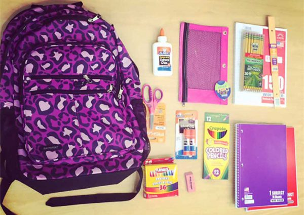 A photo of a bookbag and school supplies at Safe Shores