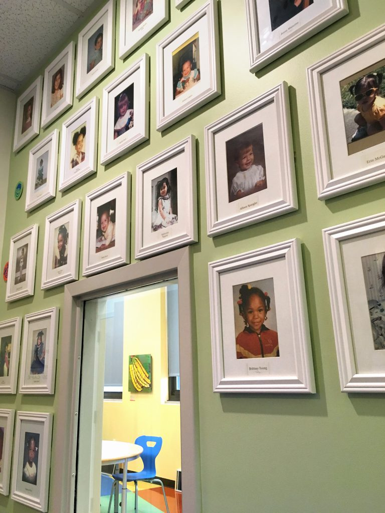 A photo of the staff photo wall at Safe Shores