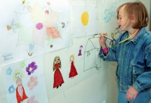 A child draws as part of a therapy program designed to help kids deal with trauma.Hidajet Delic/AP
